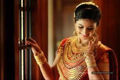 Grand Kerala Wedding Photography Kottayam - Couple : Lakshmi And Rohit , Location : Kumarakom , Composition : Team Weva , Contact : 9061040471