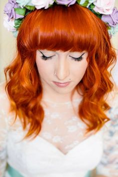 Bright red hair with a colorful flower garland.  Tux & Tales Photography