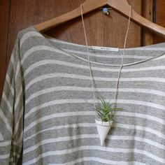 Air plant necklace = GENIUS! Pair this porcelain air plant hanger from Etsy with, say, one of our Araujei air plants and voila!