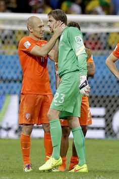 Tim Krul and Arjen Robben of the Netherlands against Costa Rica