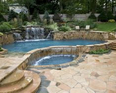 Free form pool will flagstone, waterfalls and tropical feel.