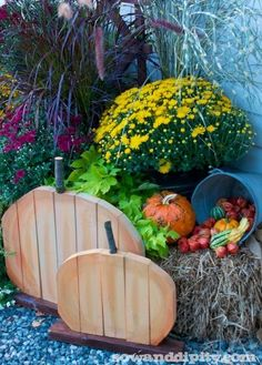 DIY Recycled Wood Pumpkins - use scrap wood to create these adorable outdoor fall decorations for your home or garden!
