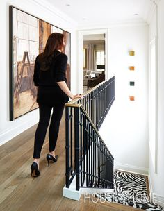 A new hand-wrought iron balustrade topped with a brass rail dramatically changes the look of designer Sloan Mauran's staircase. | Photographer: Virginia Macdonald