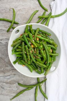 This vegetarian Green Bean Salad with Almonds (Green Bean Almondine) is made with fresh green beans, almonds, and a quick homemade honey mustard dressing. Serve it warm or cold for an easy side dish! Good Green Bean Recipe, Green Bean Recipes, Thanksgiving Green Beans, Thanksgiving Side Dishes, Green Beans Almondine, Green Beans With Almonds, Cooking Fresh Green Beans, How To Cook Greens, Homemade Honey Mustard