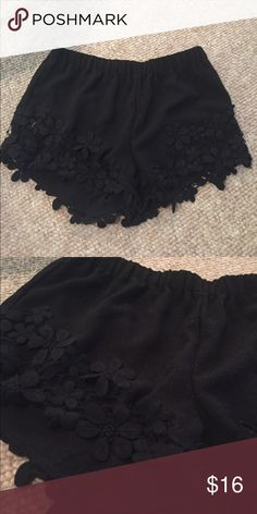 NEVER WORN Embellished black shorts Amazing for summer, the pool or going out! Al around the bottom is embellished flowers! Elastic band at top that stretches. Shorts come a little below the belly button. rebellion Shorts