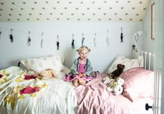 Ceiling wallpaper. Iron bed. The bedding. And if I had a little girl I'd so copy that hairdo.