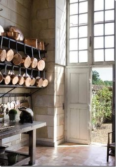love that the pans are hung on a shelf not a wall, even more storage that way