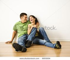 Google Image Result for http://image.shutterstock.com/display_pic_with_logo/85699/85699,1193988228,1/stock-photo-attractive-young-adult-couple-sitting-close-on-hardwood-floor-in-home-smiling-and-laughing-6693004.jpg