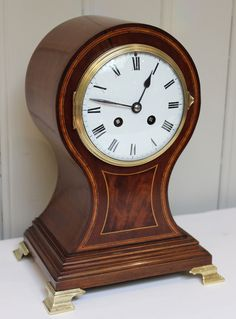 Edwardian Mahogany and Inlay Balloon Clock. Case in excellent original condition. English/French.  Circa 1910
