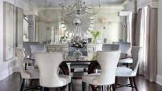 Dining Room | Morgan Harrison Home | silver starburst mirror, antiqued mirrored wall with rosette detail, custom charcoal mohair dining chairs with silver metallic backs, custom round walnut dining table