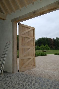 61+ Amazing Garage Door Ideas including One, Two, and Three Door Designs and Sectional, Carriage, Modern, Rustic, and Sliding Door Styles. Barn Door Garage, Barn Door Hinges, Garage Entry, Barn Doors, Modern Garage Doors, Sliding Door, Pool Houses, Modern Farmhouse, Modern Rustic