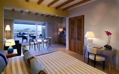Chia Village in Chia, Southern Sardinia. Garden Junior Suite with private garden, fine mosaic decorations, the carefully chosen objects and natural fabrics, together with the woven carpets based on the island's traditional designs.