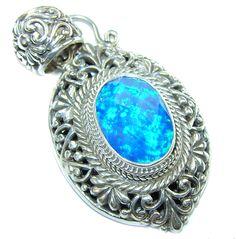 $78.15 Bali+Secret+Blue+Fire+Opal+Sterling+Silver+Pendant at www.SilverRushStyle.com #pendant #handmade #jewelry #silver #opal
