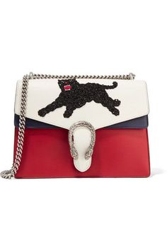 White, red and blue leather Push clasp-fastening front flap Comes with dust bag Weighs approximately 2.9lbs/ 1.3kg Made in Italy