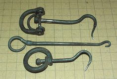 wrought-iron Scorpion-tipped sailhooks by Chris Collins