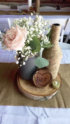 Loved it! Pinned it! A Blooming Envy Design! Wedding wine bottle centerpiece with blush roses and baby's breath.