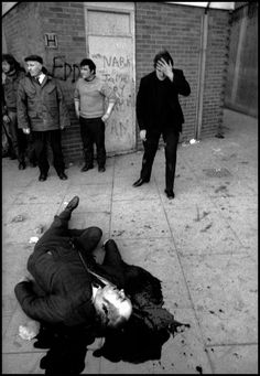 NORTHERN IRELAND. Derry / Londonderry. 30th January 1972 . A victim, Barney McGuigan, lies in a pool of blood as the shooting stops on Bloody Sunday.