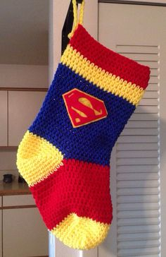 Christmas Superman Christmas Stocking by HollyCreatesbyHand Crochet Stocking, Christmas Stocking Pattern, Knitted Christmas Stockings, Crochet Christmas Ornaments, Xmas Stockings, Holiday Crochet, Christmas Sewing, Christmas Knitting, Crochet Home