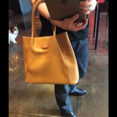 """Tod's caramel leather bag This is perfect and easy in perfect condition. If carried very lightly no signs of wear. No dust bag or tags. Height 10"""" width 13"""" depth 4"""" strap drop 8"""". Price is firm no trades or offers Tod's Bags Shoulder Bags"""