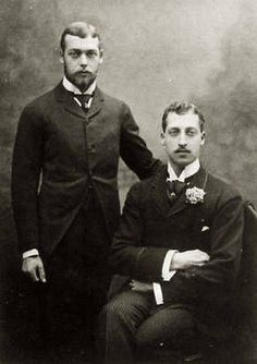 Prince George ( standing ) with his older brother Prince Albert Victor, Duke of Clarence