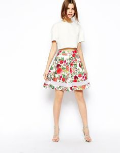 Rock this tropical print skirt on your next date night.