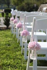 Flowers in jars along the aisle
