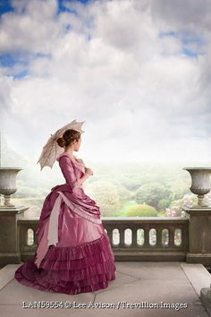 Trevillion Images - victorian-woman-standing-on-the-terrace