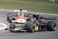 Emerson Fittipaldi (pictured behind the sideways Ronnie Peterson) wins his second world championship