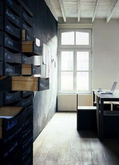 Gasp! Is that a wall of drawers with chalkboard fronts?!? I love! (photo from an artist's studio in Ghent by Frederic Verlinghaussen, via OWI.)