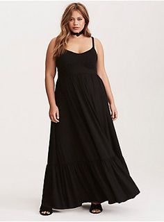"The black jersey knit on this maxi dress is so soft and stretchy you'll never want to take it off. The maxi skirt is totally boho with a tiered construction. The adjustable spaghetti straps are a flirty contrast to the very sexy paneled bodice.<div><br></div><div><b>Model is 5'8.5"", size 1 <br></b><div><ul><li style=""list-style-position: inside !important; list-style-type: disc !important"">Size 1 measures 58"" from shoulder</li><li style=""list-style-position: inside !important; l"
