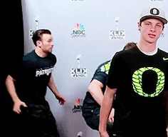 Setting up a fake photo-op at the big game, Fallon, Evans, and Pratt hid behind a curtain and popped out right as the camera snapped.   Jimmy Fallon, Chris Pratt, And Chris Evans Photobomb Surprised Fans And It's Perfect