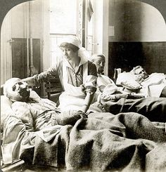 WORLD WAR I: NURSE. A nurse tending to a badly wounded soldier at a hospital in Antwerp, Belgium, during World War I, History Of Nursing, Medical History, Women's History, British History, Ancient History, World War One, First World, Old Photos, Vintage Photos