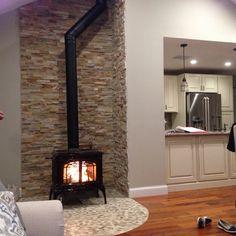 Wood stove, stone wall