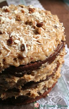 German Sweet Chocolate Cake | A traditional German Chocolate cake recipe with Coconut Pecan Frosting. Sweet and delicious!