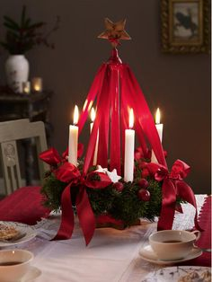 traditionell German Advent wreath. This is the wreath I'm going to make!! Love the lovely red ribbon.