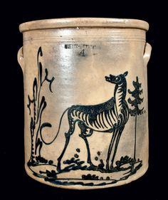 """Price Realized: $  5,290.00    Rare Four-Gallon Stoneware Crock with Elaborate Cobalt Dog Scene, Stamped """"WHITES UTICA',"""" NY State origin, circa 1865, cylindrical crock with heavily-tooled shoulder, semi-rounded rim, and applied lug handles, decorated with an artistically-rendered cobalt scene depicting a large standing dog with turned head and heavily-shaded body, flanked by a pine tree and tall stump. Various s"""