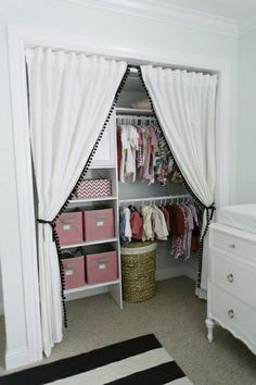 I love the idea of making a nursery closet bigger and more usable by  removing the closet door(s), but adding this curtain ...