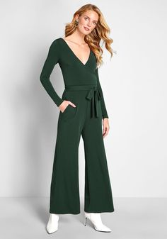 Elegant Everywhere Long Sleeve Jumpsuit - Highlight your propensity for polish with this dark green jumpsuit from our ModCloth namesake label! Crafted from a stretch-infused crepe fabric, and detailed with long sleeves on either side of the surplice neckline, a sleek waist sash, and essential pockets, this wide-leg one piece is a surefire stunner for casual outings and swanky occasions alike.