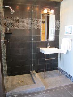 bathroom with black square shower tiles