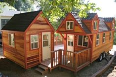 molecule-tiny-house-with-companion-studio-001 -- The tiny home on wheels is 8'6″ wide, 18′ long, and 13'5″ tall. It was sold for $75,000 with the decks (front and back), companion studio, and set up by Molecule Tiny Homes in California.