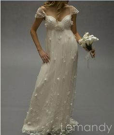 ivory cap sleeves sweetheart column empire waist tulle mature wedding dress with flowers. $238.00, via Etsy.