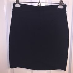 NWT - Express Black High Waisted Mini Skirt, 4 NWT - Express black high waisted mini skirt. Has a v-cut in the front and the front is slightly shorter than the back. Zips up the side. Size 4. Lining 100% polyester. Shell: 68% rayon, 28% nylon, 4% spandex. Express Skirts Mini
