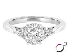 This 1.03ct three stone diamond engagement ring is set in 18k white gold. The centre diamond is an oval cut and has a carat weight of 0.63ct. It is complimented by two trillion cut diamonds either side of it.  You can view this ring in more detail by clicking on the link provided or by visiting the Commins & Co tore located in the prestigious Powerscourt town centre, Dublin, Ireland.