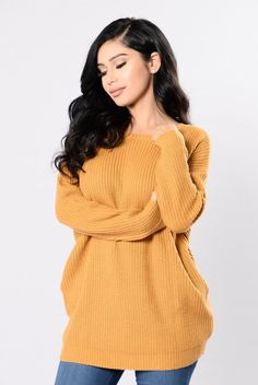 - Available in Rust, Mustard, Black/White, and Olive - Back Button Detail - Oversized - Long Sleeve - Side Slit Pockets - 100% Acrylic