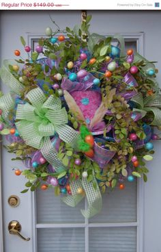 Deco Mesh Easter Wreath with lots of floral embellishments. I've seen many deco-mesh wreaths and I really LOVE this one because of the embellishments. Easter Wreaths, Holiday Wreaths, Holiday Crafts, Christmas Decorations, Spring Decorations, Wreath Crafts, Diy Wreath, Wreath Ideas, Diy Spring Wreath
