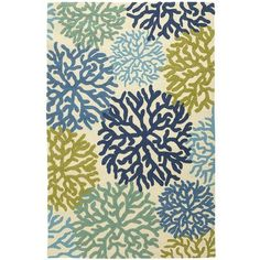 Our coral-patterned rug brings the cool colors of the reef to your casual indoor and covered outdoor areas, in hand woven 100% olefin that's softer than wool underfoot. Also better? It's durable enough to rinse off with a hose.