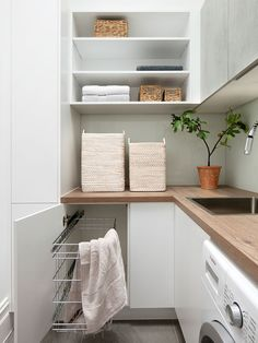 Who says that having a small laundry room is a bad thing? These smart small laundry room design ideas will prove them wrong. Grey Laundry Rooms, Laundry Room Storage, Laundry In Bathroom, Laundry Area, Laundry Basket, Grey Kitchens, Cool Kitchens, Kitchen Grey, Kitchen Wood