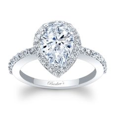 Stunning, in vogue, this white gold diamond halo engagement ring will capture the eye of many admirers. Shared prong set diamonds encircle the fancy pear shape diamond center and cascade down the dainty shank for a look of sheer elegance.<br /> <br /> Also available in 18k and Platinum.