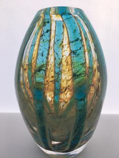 A stunning Vintage Mdina Glass Vase In the  Blue Crystal  pattern. 16.5cm tall.