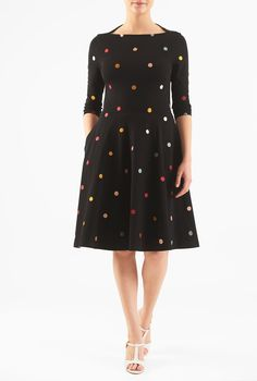 A high back neck highlights the boat neck front in our colorful polka dot embellished dress cut from stretchy cotton knit.
